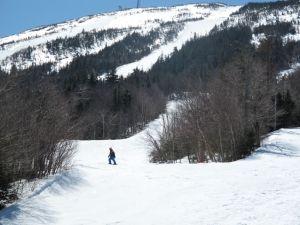 Skier ponders, hmmm, Sluice or Spillway?